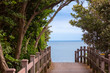 Footpath in a green park leading to the sea, Jeju Island, a travel to South Korea