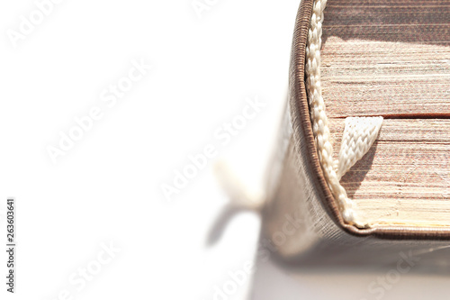 Top View of a Hardcover Book with Head, Spine and a White Fabric Bookmark Isolated on White Background Tapéta, Fotótapéta