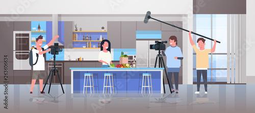 Fototapeta operators using video camera recording food blogger woman preparing tasty dishes
