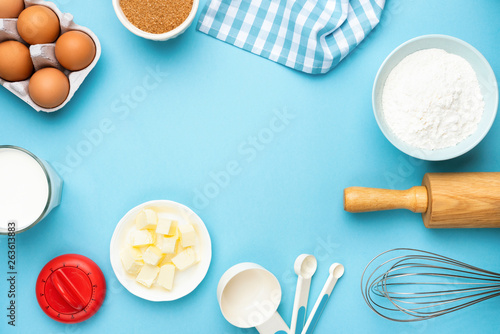 Photo  Baking utensils and ingredients on blue background
