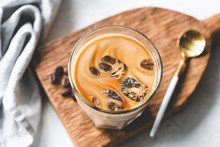 Ice Coffee In Glass On Wooden ...