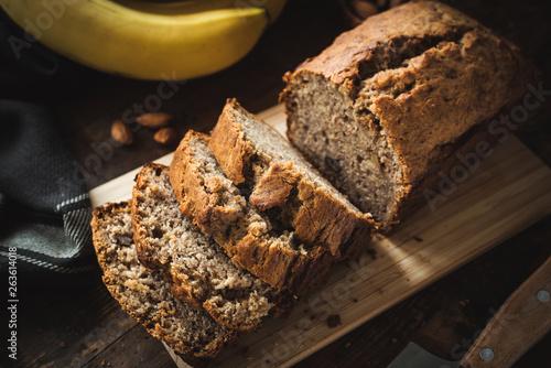 Obraz na plátně Homemade banana bread or cake loaf sliced on wood
