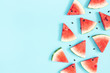 canvas print picture - Watermelon pattern. Red watermelon on blue background. Summer concept. Flat lay, top view, copy space