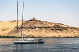 Egypt Sailing boat The Nile river Aswan West Bank Tombs Qubbet el-Hawa Dome of the Winds tomb of Muslim prophet