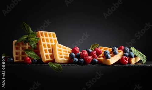 Waffles with blueberries, raspberries and fresh mint.