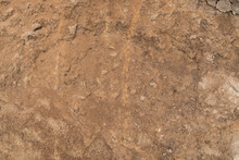 Grunge Texture Of Red Dry Clay. Close Up Of Dirt Soil Background