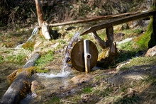 Small Water Wheel With A Pond In The Forest
