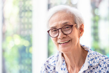 Close Up Asian Elderly Woman In Glasses Showing Healthy Straight Teeth,portrait Senior Woman Smiling Feeling Happy,beautiful Female Looking At Camera In Home