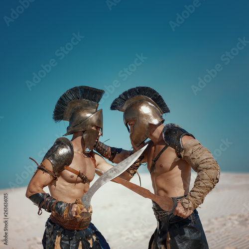 Fotografie, Obraz Male athlete in the armor of an ancient warrior