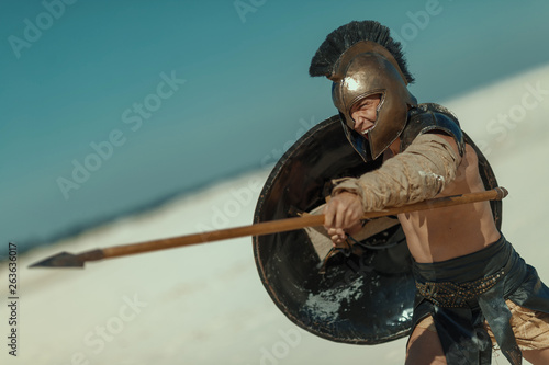 Male athlete in the armor of an ancient warrior Canvas Print