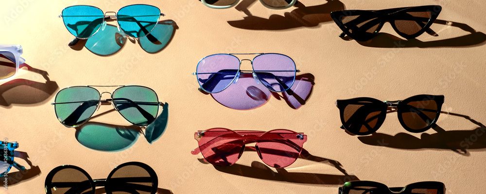 Fototapeta Variety of sunglasses over colorful background