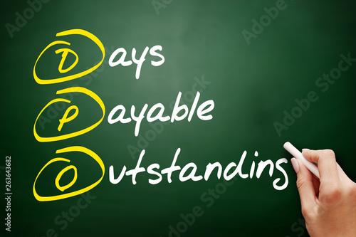 Fényképezés  DPO - Days Payable Outstanding acronym, business concept on blackboard
