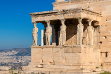 Ancient  Erechtheion Temple With Caryatid Porch On The Acropolis Near Parthenon, Athens, Greece.
