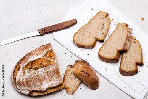 Canvas Tasty dark bread on white background, copy space