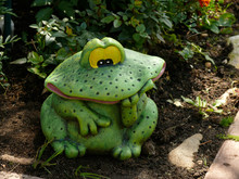 Decorative Frog In The Garden. Close-up