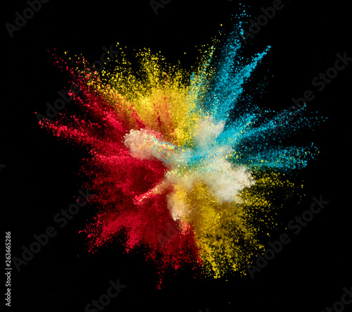 Explosion of colored powder on black background - 263665286