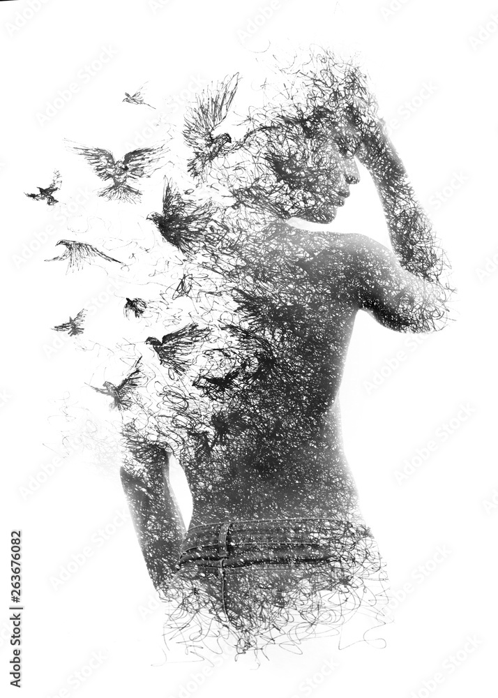 Fototapeta Paintography. Double exposure of a shirtless male model combined with handmade pen drawing of birds flying away and disintegrating, black and white