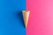 Leinwanddruck Bild - Ice cream cornet over blue and pink background