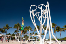 South Beach, Florida. Man Standing On His Hands On Parallels Bars