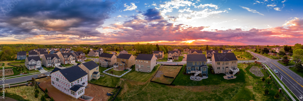 Fototapety, obrazy: Aerial view of new construction street with luxury houses in a Maryland upper middle class neighborhood American real estate development in the USA with stunning sunset color sky