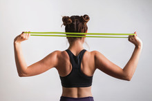 Young Athletic Woman Doing Exercises With Fitness Rubber Band