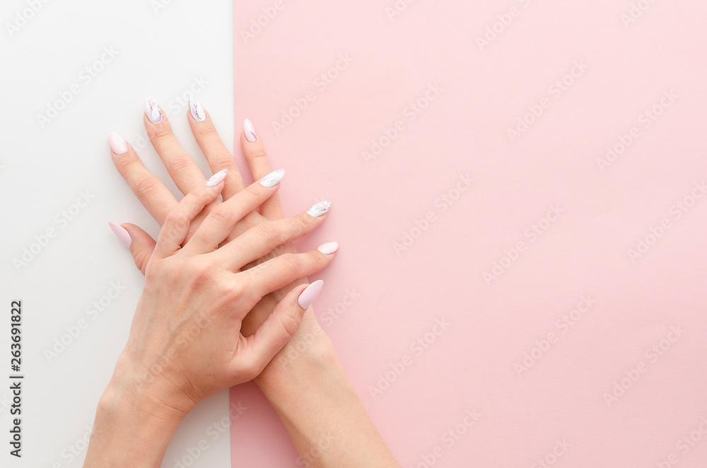 Fototapety, obrazy: Top view woman's hands manicure with nail painting work. Drawing on nails banner concept for a beauty salon with copy space