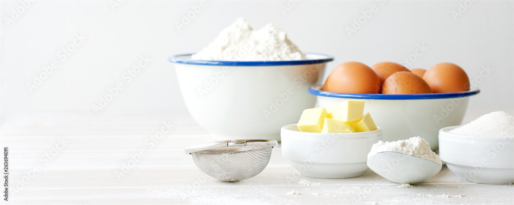 Fototapety, obrazy: Ingredients for making dough, dessert on white wooden table. Flour, butter, sugar, eggs ingredients