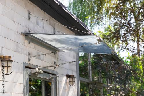 Obraz na płótnie glass awning canopy of house and garden background