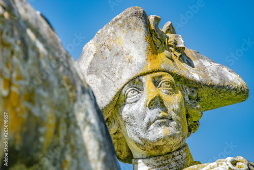 Fotografie, Obraz  Very old statue of Prussian King Frederick the Great covered with moss and liche