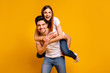 Leinwanddruck Bild - Portrait of his he her she two nice attractive adorable cheerful optimistic tender people wife husband having fun spare time isolated over vivid shine bright yellow background