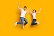 Leinwanddruck Bild - Full length body size photo funky she her he him his pair jumping high raised fists yell scream shout loud cheerleader football fans wear casual jeans denim white t-shirts isolated yellow background