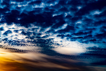 mystically blue clouds at sunset