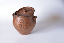 A Vessel Of Clay On A Light Ba...