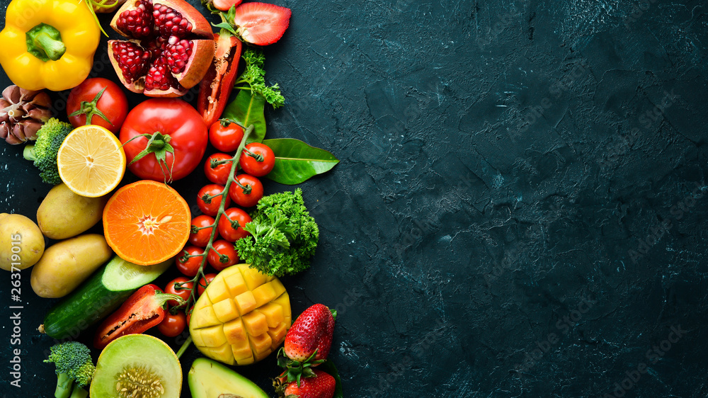 Fototapety, obrazy: Fresh fruits, vegetables and berries. On a black background. Banner Top view. Free space for your text.