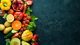 Fresh fruits, vegetables and berries. On a black background. Banner Top view. Free space for your text.