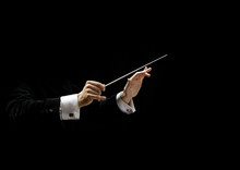 Hands Of Conductor On A Black ...