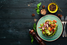 Vegetable Salad With Avocado And Veal. In The Plate. Top View. Free Space For Your Text. Rustic Style.