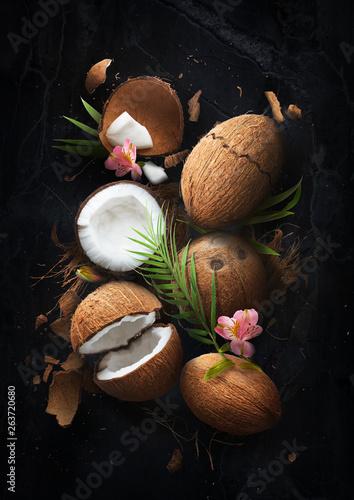 Fresh ripe coconut on dark marble background Fotobehang