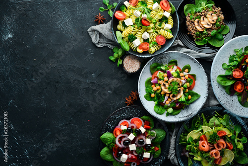 Aluminium Prints Equestrian Assortment of food. Folk cuisine on a black wooden background Top view. Free space for your text. Flat lay