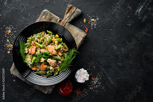 Aluminium Prints Equestrian Risotto with chicken fillet and vegetables. Rice. Top view. Free copy space.