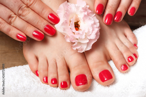 Canvas Prints Pedicure Pink manicure and pedicure with flower close up, wooden background, top view