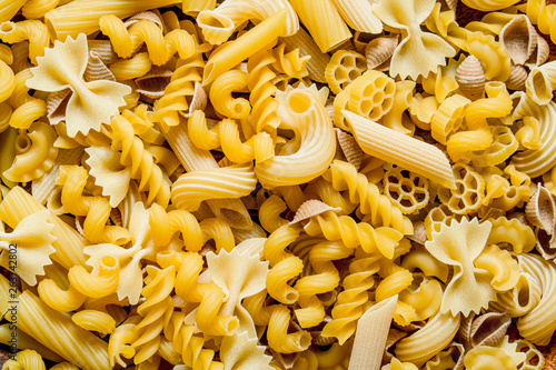 Slika na platnu Different types of pasta dry.