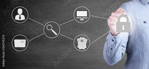 Fotografie, Obraz  businessman draws graphics people technology block lock communication