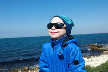 Boy On Black Sea Background