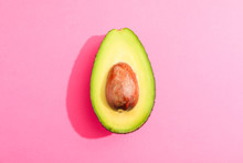 Rip Cut Avocado On Pink Background, Space For Text