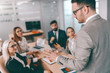 canvas print picture - Serious CEO talking to employees on business meeting in board room. You don't dram about success, you work for it.