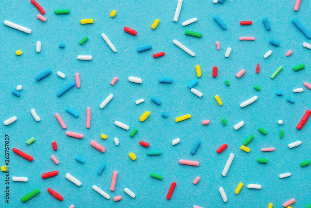 Fototapety, obrazy: colorful sprinkles over blue background, decoration for cake and bakery
