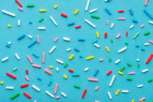 Colorful Sprinkles Over Blue B...
