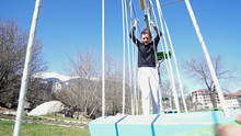 Teen Girl In Adventure Park. Adventure Park Is Place Which Can Contain Wide Variety Of Elements, Such As Rope Climbing Exercises, Obstacle Courses And Zip-lines. They Intended For Recreation