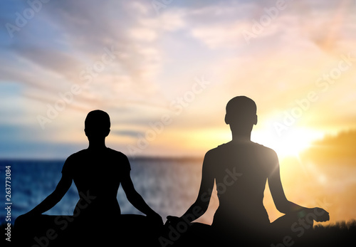 Mindfulness Spirituality And Outdoor Yoga Silhouettes Of Couple Meditating In Lotus Pose Over Sunset And Sea Background Buy This Stock Photo And Explore Similar Images At Adobe Stock Adobe Stock